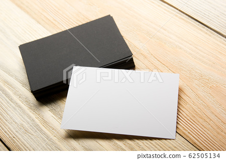 Business card blank on wooden background. Corporate Stationery, Branding Mock-up. Creative designer desk. Flat lay. Copy space for text. 62505134