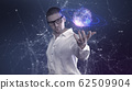 A male scientist in a white shirt holds an abstract ball in his hands against a background of plexus 62509904