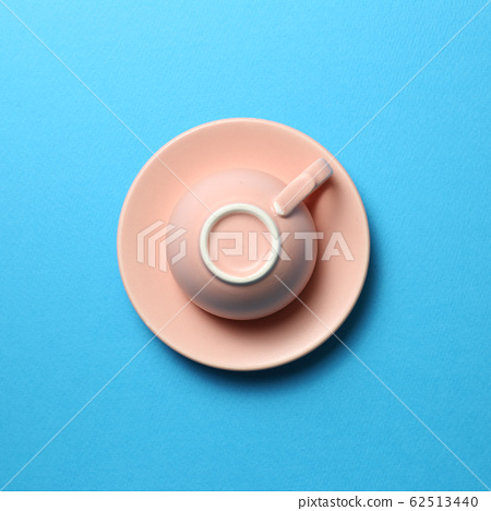Pink coffee cup on blue background 62513440