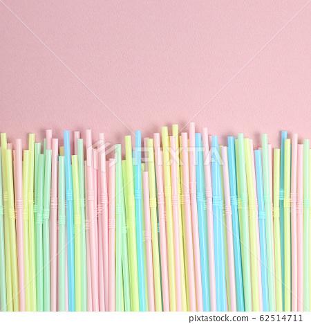 Pastel color straws on pink background 62514711