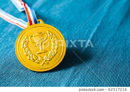 Gold medal on blue background 62517218