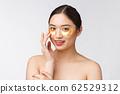 Asian beauty teenager woman care her skin with gold eye masks patches under eyes 62529312