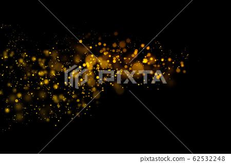 Golden light bokeh and abstract glittering on dark 62532248