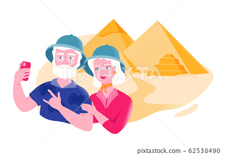 Senior couple in safari hats is taking selfie near the Egyptian pyramids. Active leisure and special offers for older people. Elders seeing the world. Senior tourism and burning tickets to famous plac 62538490