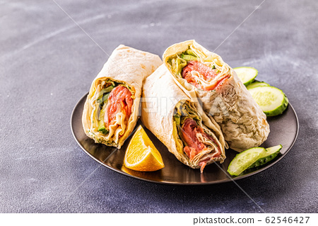 Wrapped sandwich with salmon, lettuce, cucumber 62546427