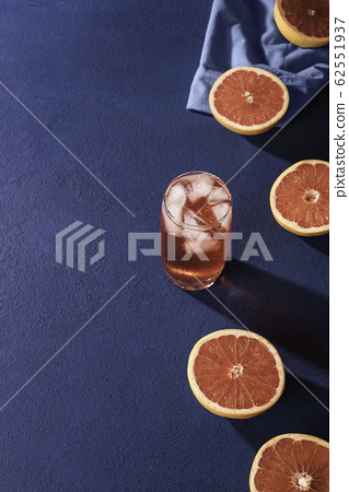 Grapefruit drink and slices citrus fruits. 62551937