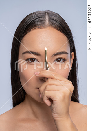 Portrait of attractive woman that looking at camera 62553028