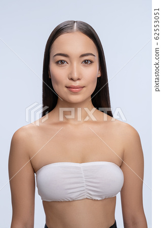Portrait of cute female that looking at camera 62553051