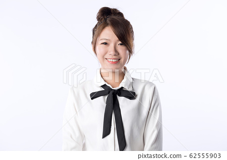Young Asian girl smiling happily 62555903