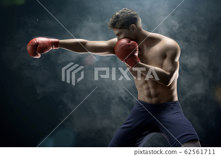 Boxer throwing a right cross 62561711