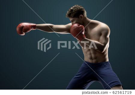 Boxer throwing a right cross 62561719