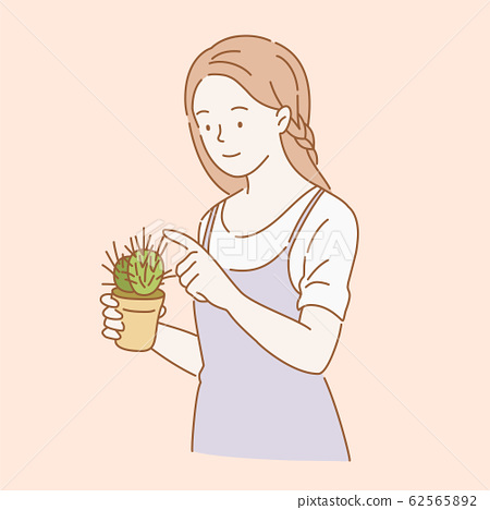 Woman holding a cactus 62565892