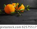 Fresh citrus fruit on the table 62575517
