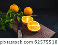 Fresh citrus fruit on the table 62575518