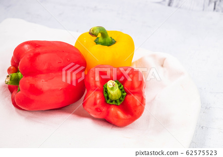 Fresh paprika on the wooden background 62575523