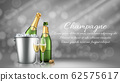 Champagne bottle in ice bucket and two full glasses 62575617