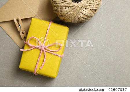 Gift box and kraft envelopes on gray background 62607057