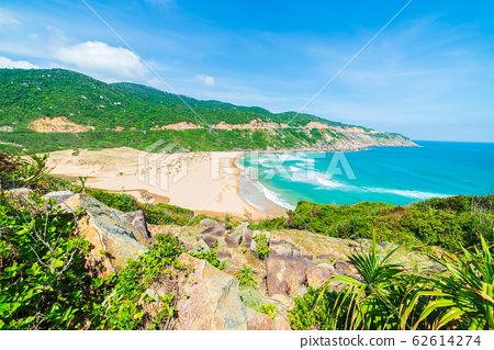 Expansive view of scenic tropical coast from cliff 62614274