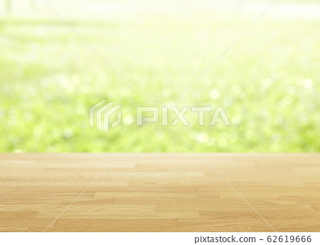 Wood table top on bokeh Green background 62619666