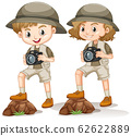 Boy and girl in safari outfit with camera standing 62622889