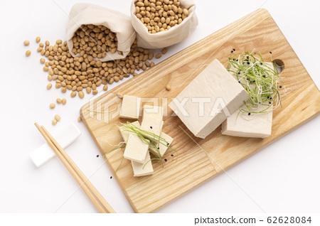 Alternative food. Soybean cheese Tofu with fresh Microgreens 62628084