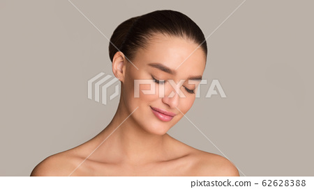 Beautiful girl face with closed eyes and perfect skin 62628388