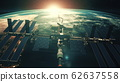 Close up ISS flying over Earth globe atmosphere 62637558