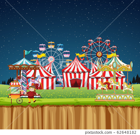 Circus scene with many rides at night time 62648182