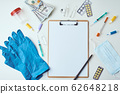Top view of medical items and empty paper blank 62648218