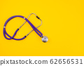 Medical stethoscope on trendy yellow background. Copy space. 62656531