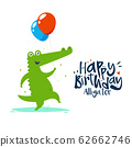 A green alligator is holding two balloons on his 62662746