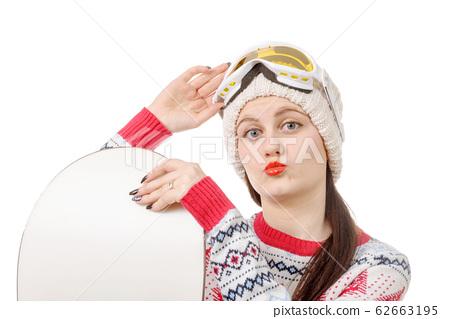 beautiful woman with a snowboard in studio 62663195