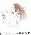 건조기에서 긴 머리를 말리는 젊은 여성 62666643