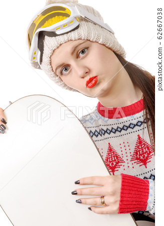 beautiful woman with a snowboard in studio 62667038