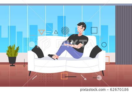 sick man with fever and red rash coronavirus infection symptoms epidemic MERS-CoV virus wuhan 2019-nCoV pandemic health risk concept living room interior full length horizontal 62670186