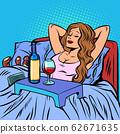 a woman drinks wine alone 62671635