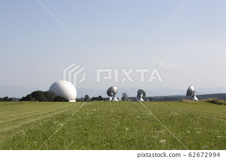 Earth station in a meadow 62672994
