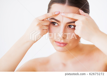Problem Skin. Woman Crushing Spot On Face And Looking In Mirror 62673272