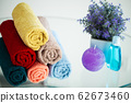 Colored towels on white table with copy space on bath room background 62673460