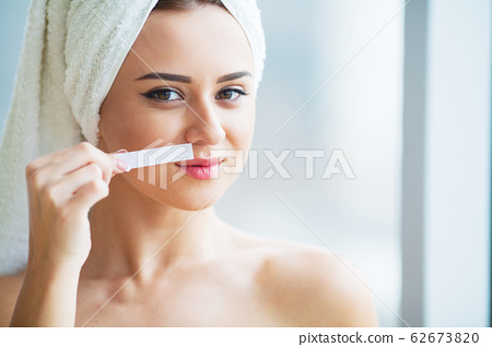 Hair Removal Wax. Young woman reciving facial epilation 62673820