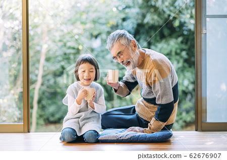 Grandpa and grandchild tea time 62676907