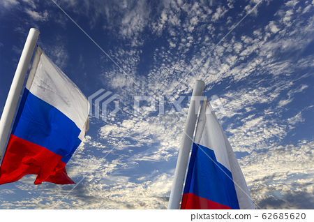 Russia flag waving in the wind against the sky. 62685620