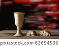 Still life with chalice of wine and bread 62694530