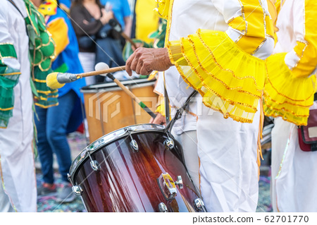 The drummer plays the rhythm of the march at the carnival. Portugal Brazil 62701770