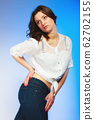 plus size woman in casual clothes posing in studio 62702155