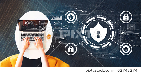 Cyber security theme with person using a laptop 62745274