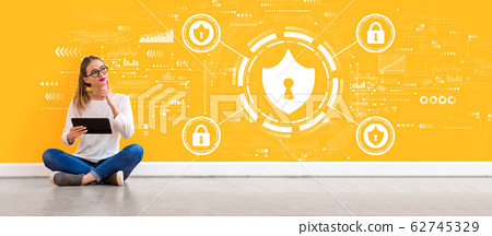 Cyber security theme with woman using a tablet 62745329