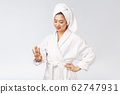 beauty asian girl who checks her skin. skin care. Isolated over white background. 62747931