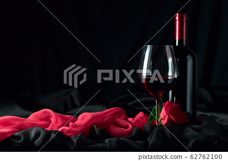 bottle and glass with red 62762100