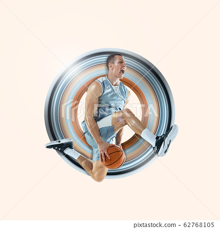 Full length portrait of a basketball player with ball 62768105